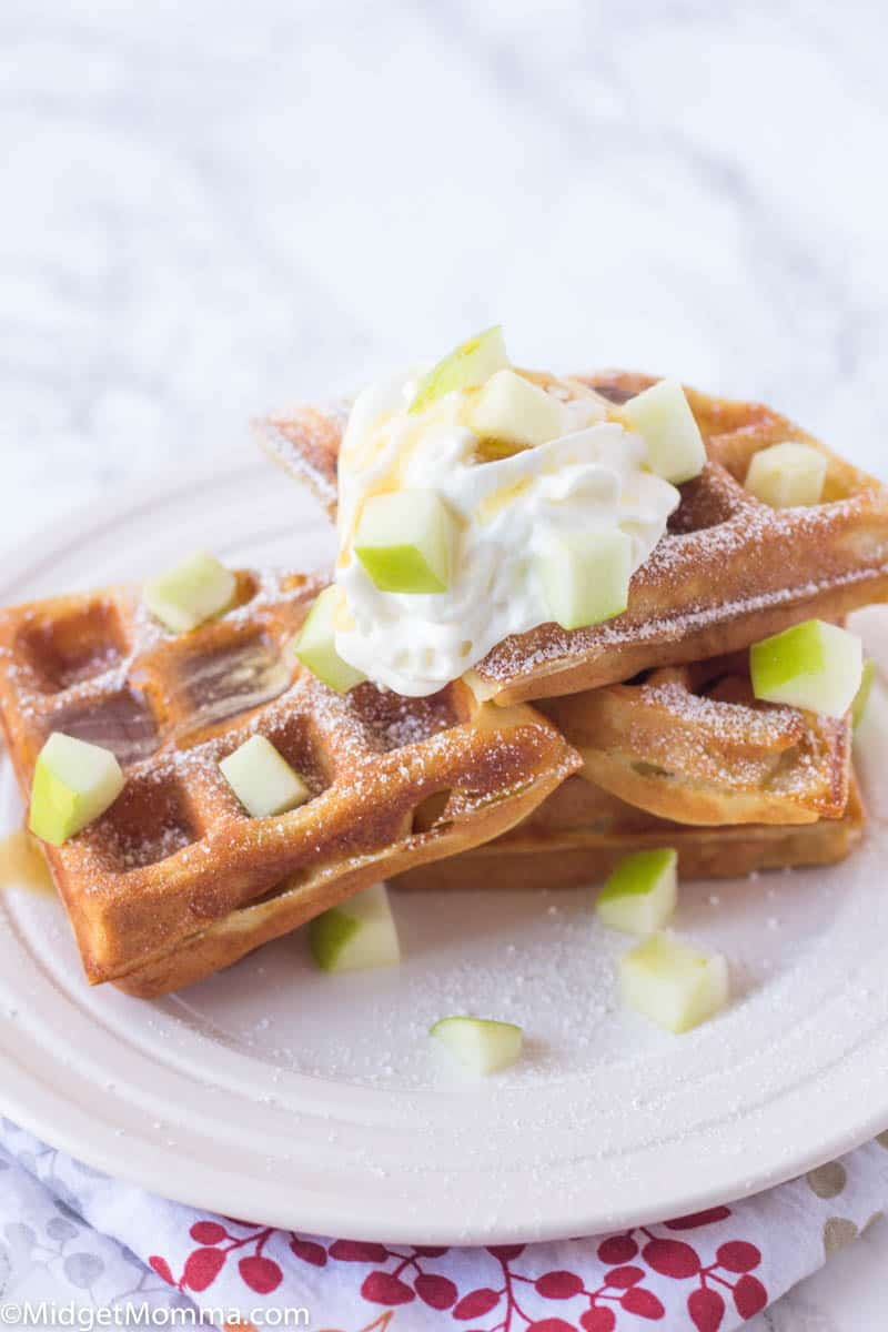 apple cinnamon waffles with diced apples and whipped cream
