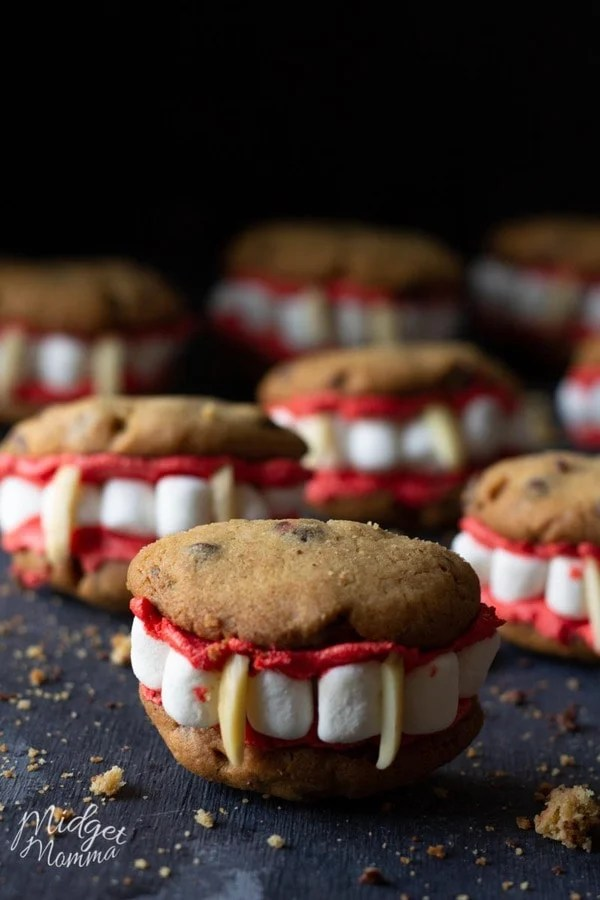 Chocolate chip cookies, with red frosting, marshmallows and almonds to form a vampire mouth
