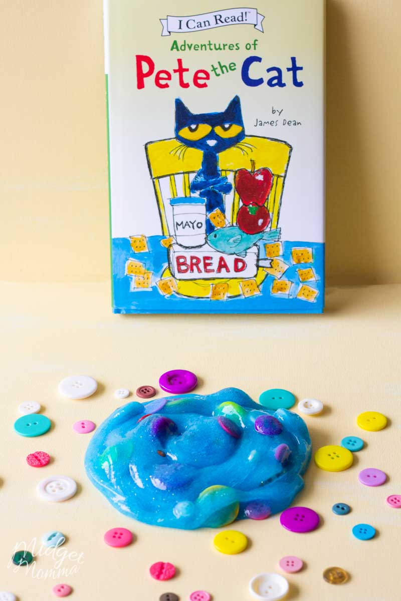 Glitter slime in blue color with button addins