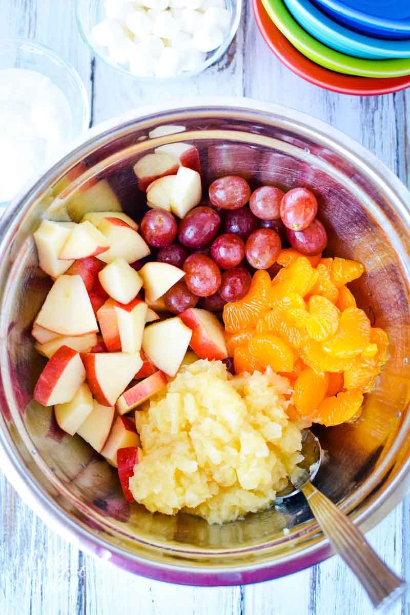 Bowl of fruit prepped to make fruit salad, bowl is filled with mandarin oranges, grapes, apples and pineapples!