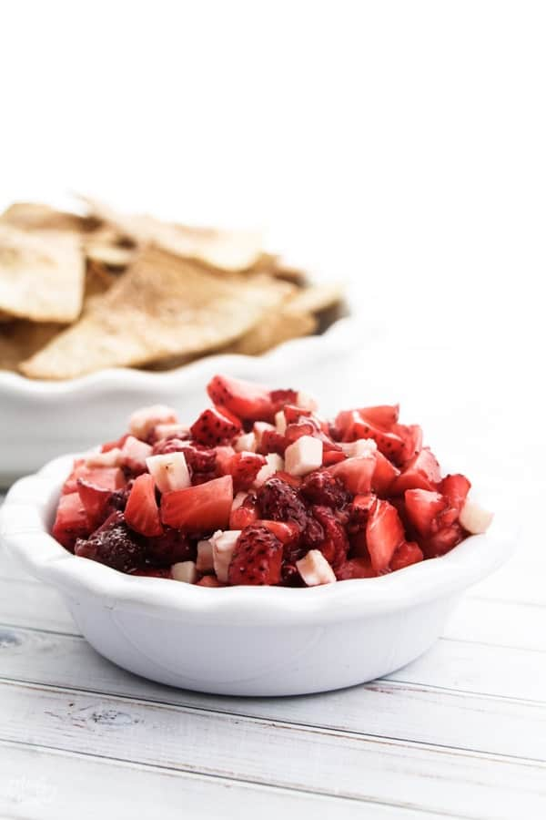 strawberry dessert salsa in a bowl with cinnamon sugar tortilla chips