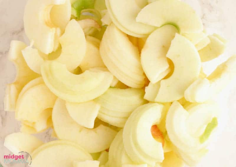 peeled and sliced apples in a bowl