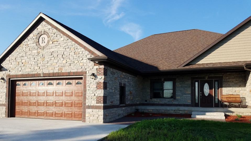 house with masonry siding
