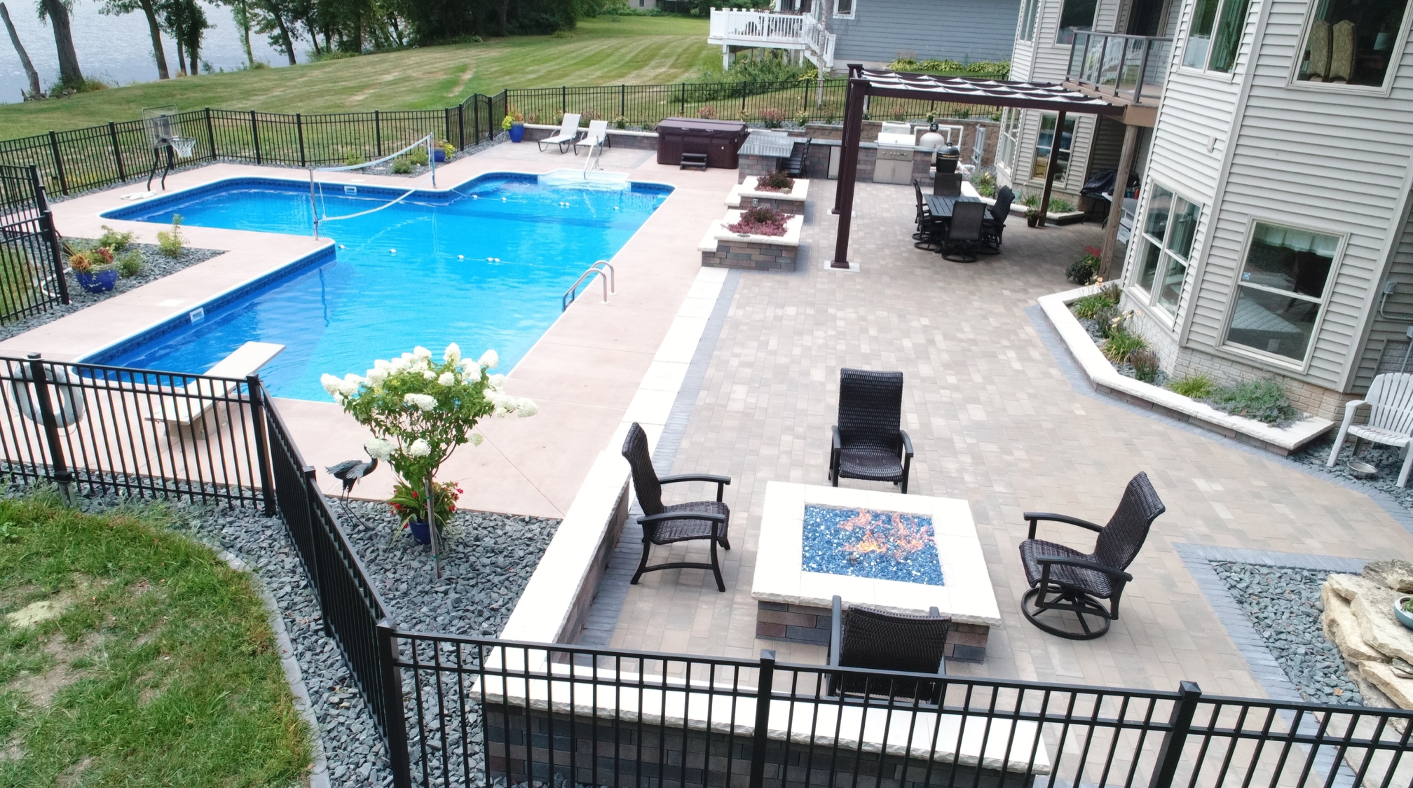 pool with patio and landscaping
