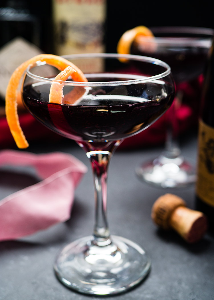 A grapefruit infused gin, Lillet Rouge and Lambrusco cocktail. This romantic Oscar-Worthy Cocktail is named Je T'attendrai and inspired by The Umbrellas of Cherbourg. Sponsored by Drizly.