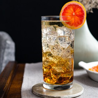 A fruity twist on a classic vermouth spritzer. The Mean Reds Crusher is a low-alcohol Oscar-Worthy Cocktail inspired by Breakfast at Tiffany's.