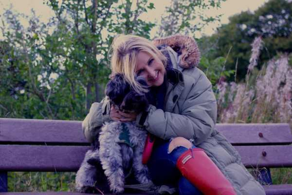 Christine, founder of The Key with her dog