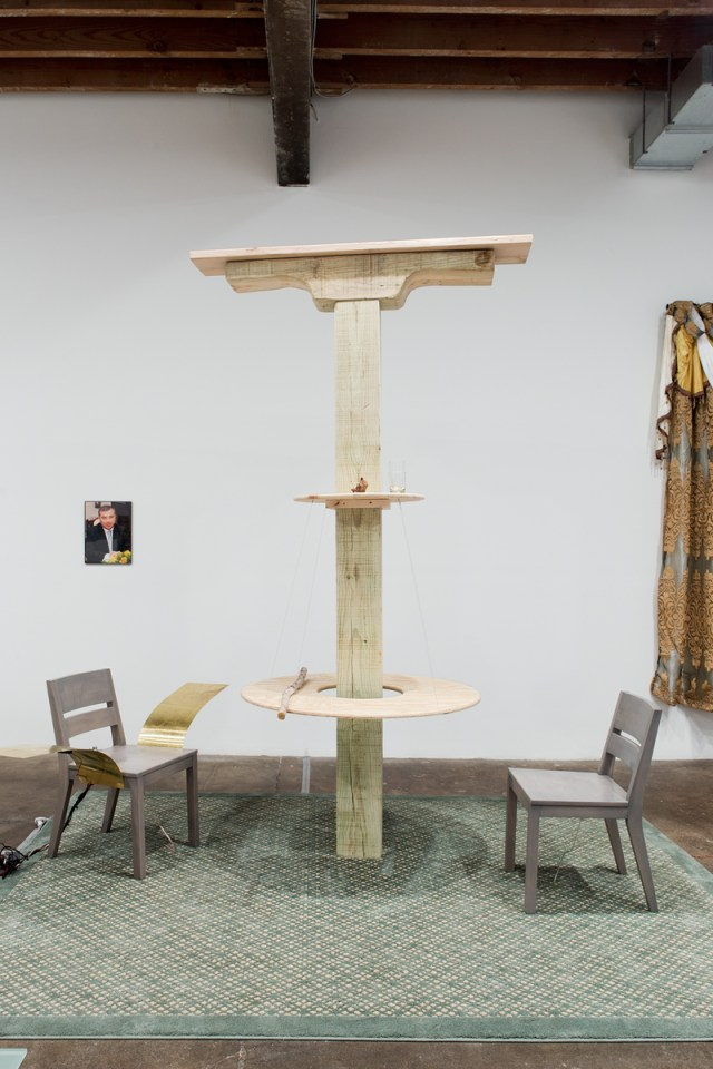 Deda Bodzi Table with a Shelf, 2016. Wood, birch branch, glasses, wooden object, metal wire. 121 x 94 x 110 inches.
