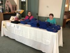 175th Anniversary sale table for T-shirts and cookbooks