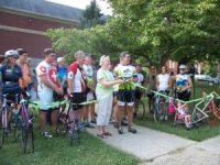 Cyclists and church members at bike rack dedication
