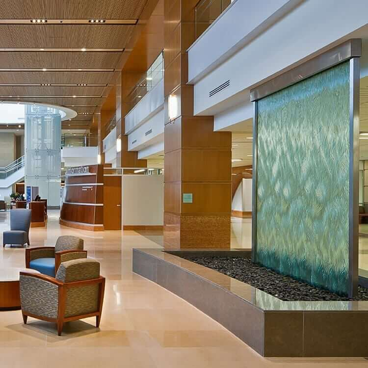 textured glass water wall university of kentucky patient care facility interior fountain