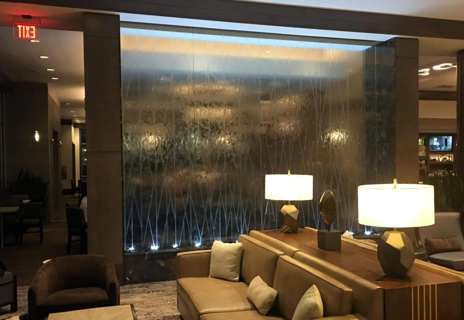 Glass Water Wall with Etching Logo Design at Embassy Suites Katy Texas