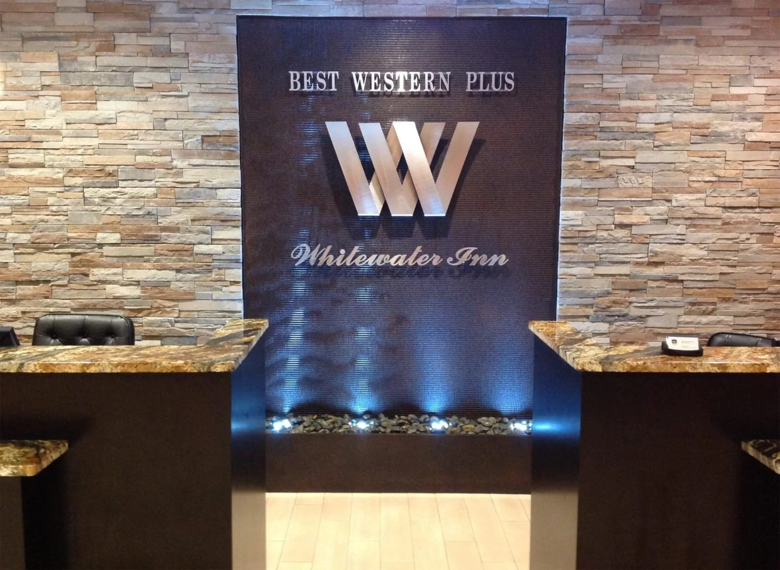 hotel water wall harrison ohio water feature front desk brown scored acrylic 2 1