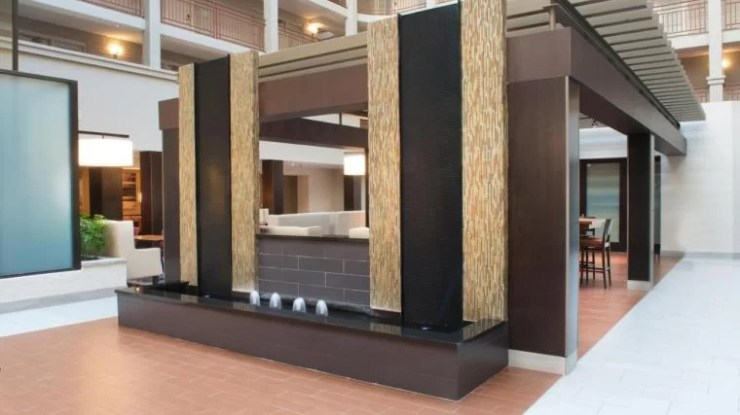 Black Scored Acrylic Water Wall Aquafall with Reflection Pool and Bubbler Jets at Embassy Suites Denver Colorado