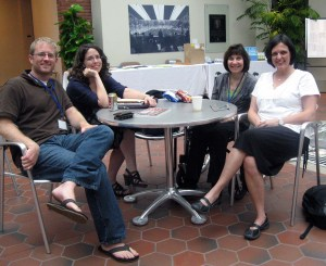 Kelsey Timmernan, Jane Friedman, Jama Bigger and Cathy Day chat in the atrium.