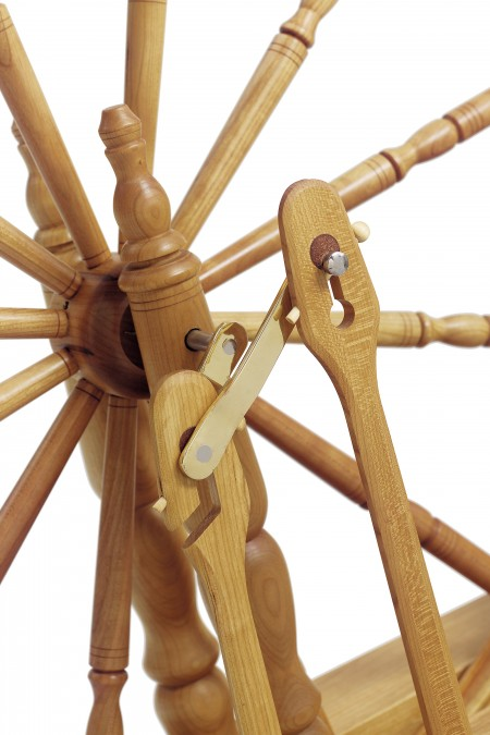 Close-up of crank on a Schacht-Reeves spinning wheel in cherry.