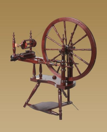 Polonaise spinning wheel with mahogany finish.