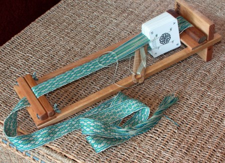 Beka 4 Inch Rigid Heddle Loom - Shown here holding a cardweaving project.