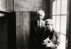 Jan and Miep Gies in the Secret Annex next to the bookcase that closed off the entrance, around 1988.