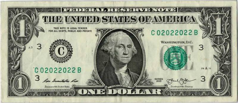 dollar bill with a binary fancy serial number