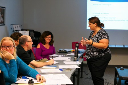 Jennifer working with small group in marketing workshop