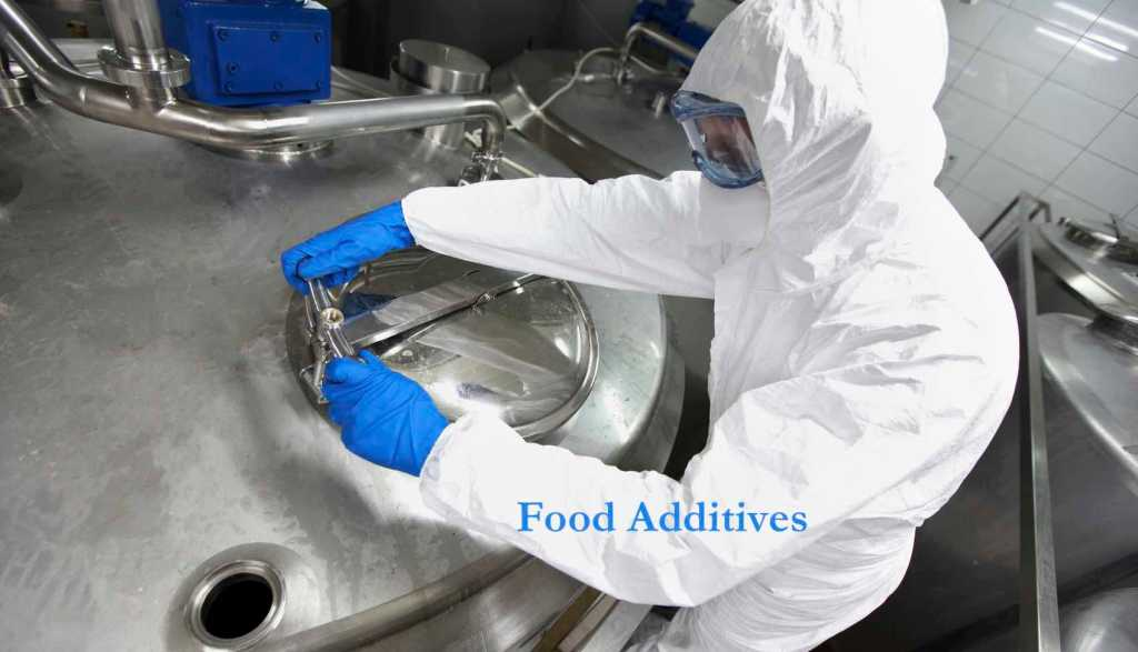 technician opening industrial process tank. Migraine Trigger: Food Additives