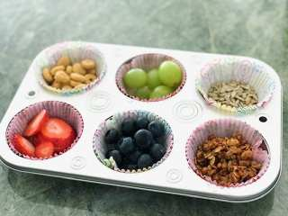Muffin tin with fruit, seeds and granola