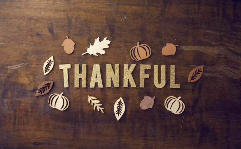 block letters spell our thankful reminding us to practice gratitude