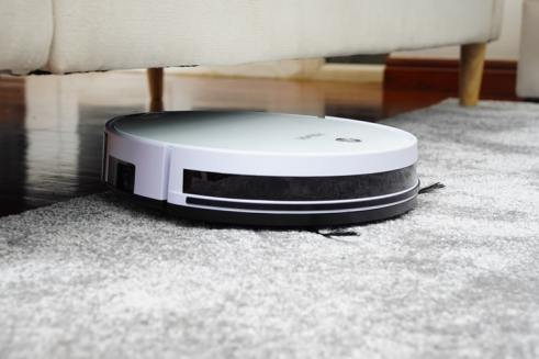 roomba vacuuming the carpet