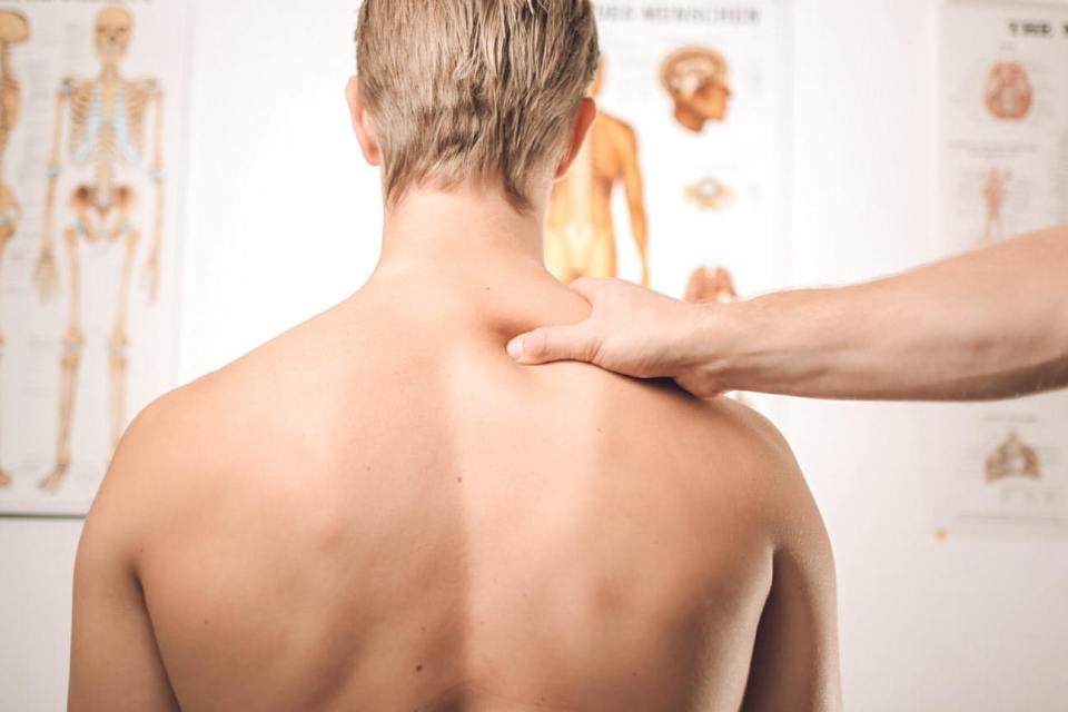 man getting treatment from a chiropractor for migraine relief