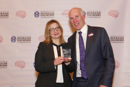 woman accepting an award from man for advocating for cannabis for migraine