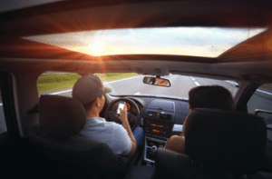 man driving with a friend