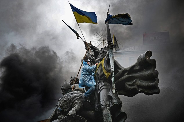 Anti-government protesters, continue to their clash with police in Independence square, despite a truce agreed between the Ukrainian president and opposition leaders in Kiev, Ukraine.