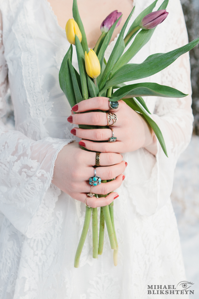 Closeup of a young woman's hands holding a bouquet of flowers ou