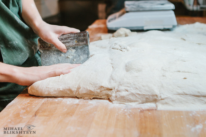 Shaping dough at a commercial artisinal bakery for baking