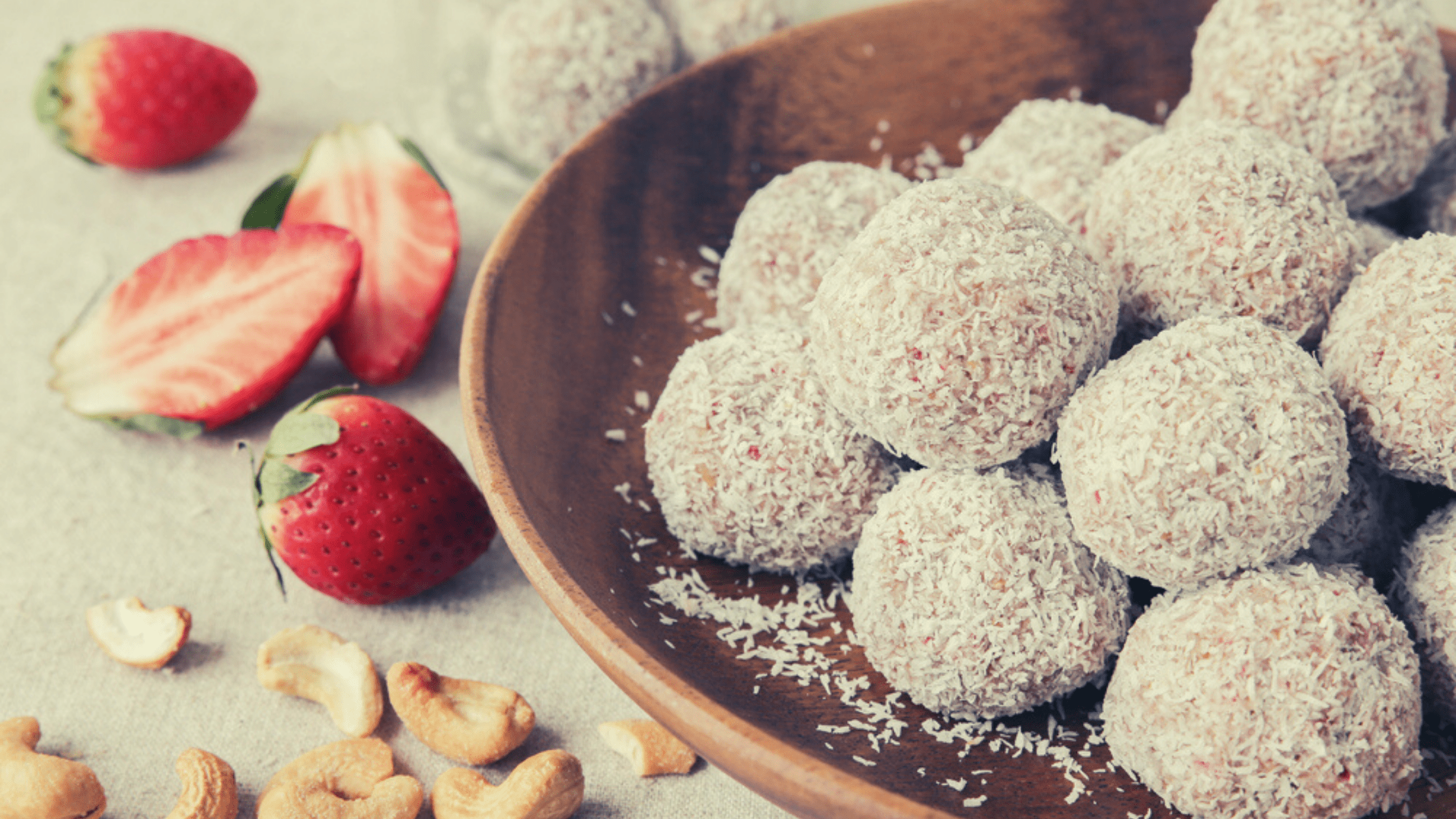 Nut free coconut bliss balls with strawberries