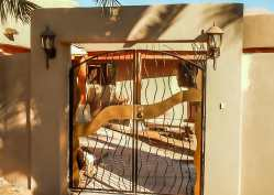 Bent twisted metal with gold sheet metal accents -RV Gate