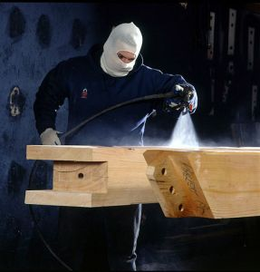 """""""Worker Applying a Wood Finish"""" by Vermont Timber Works Inc. - http://www.vermonttimberworks.com/home/framing/tools/index.html. Licensed under CC BY-SA 3.0 via Wikimedia Commons - https://commons.wikimedia.org/wiki/File:Worker_Applying_a_Wood_Finish.jpg#/media/File:Worker_Applying_a_Wood_Finish.jpg"""