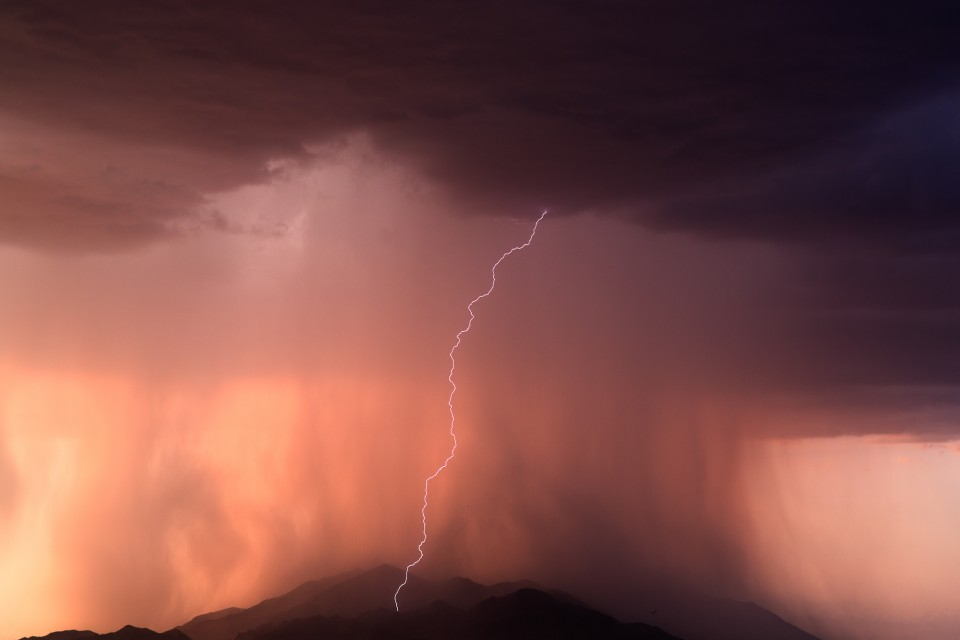 A lone bolt of lightning strikes the Sierra Estrella Mountains northwest of Maricopa, AZ. This downpour was awesome to watch as it just cascaded off the mountains.