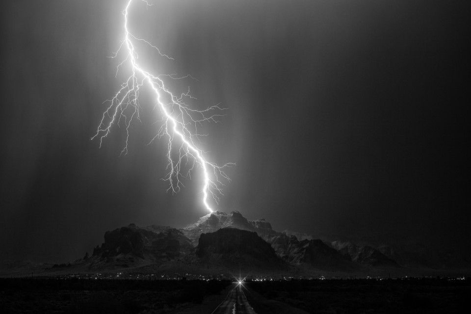 An early morning thunderstorm over the Superstition Mountains on July 3rd delivered a couple of magical lightning strikes. This one in particular is one of my favorites...a single, powerful bolt landing at almost the highest point of the mountain. I'm a huge comic book fan and if anything looked like the arrival of Thor from Asgard, this is it.