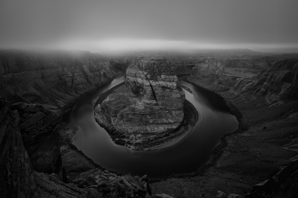 A low layer of fog flows over Horseshoe Bend during an inversion over northern Arizona that lasted for several weeks.