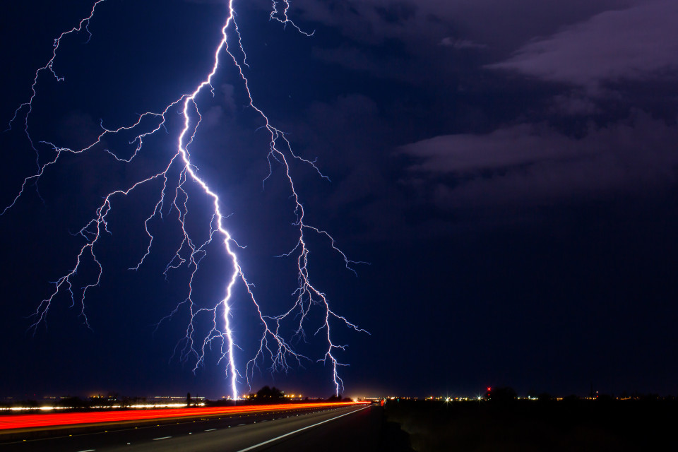 A huge, powerful positive cloud-to-ground lightning strike lands around Gila Bend on September 13th, 2015. Positive strikes are 10 times more powerful than a normal one, and they tend to originate near the top of a thunderstom and can land up to 10 miles away. On this one you'll notice the rain is actually off to the right of the photo, so this strike was well away from there. One of the deadly aspects of lightning.