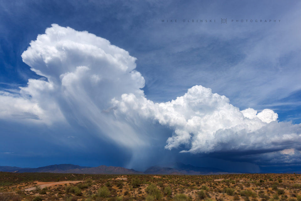 An incredibly cooll scene out at the Four Peaks on July 1st, 2016. Strong winds push a dumping hail core way out ahead of the updraft and on top of the Four Peaks Mountain Range.