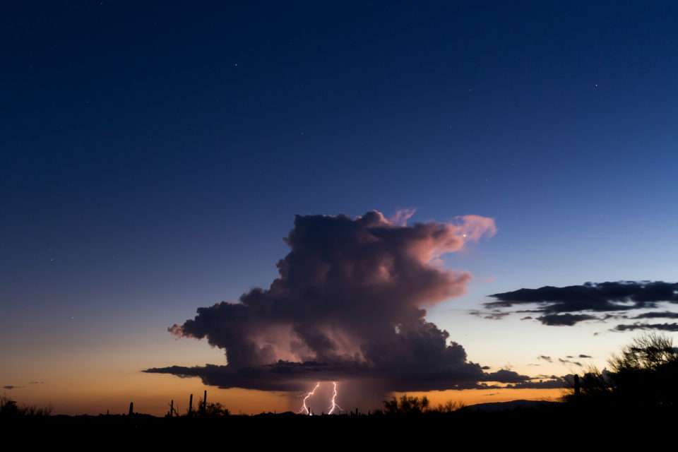 A beautiful, isolated storm hangs in western portions of Arizona right at sunset.