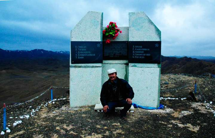 Amar in front of the memorial to ten Mongolian soldiers who fought to the last man here in 1948.