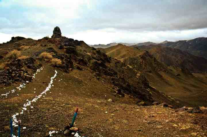 In the remote corner of Mongolia's southwest, within the restricted border zone, a white stone lined footpath leads up a ridge....