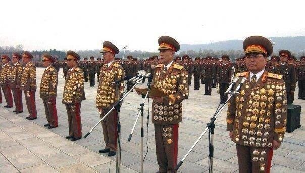 Scientology ideal scene -- North Korean Generals displaying their baubles of dubious distinction