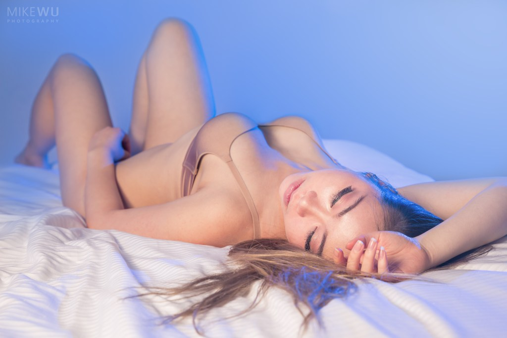 vancouver portrait photographer mike wu indoor studio boudoir photography unique blue gel style sylvie sexy nude lingerie asian chinese bed lying down rest passion exclusive