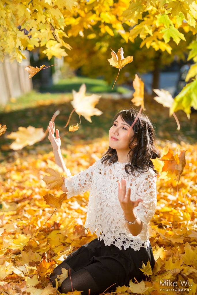 vancouver portrait photographer mike wu fall autumn leaves colour sunset rake female happiness falling yard chinese asian female