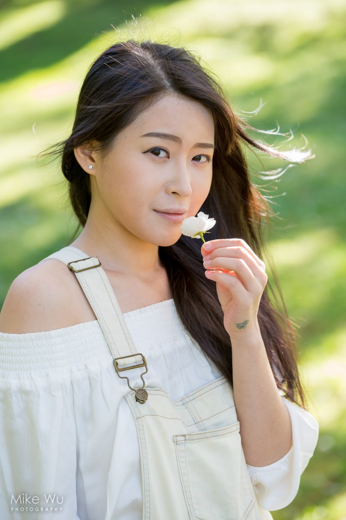 hair, sun, breeze, wind, flower, cherry blossom, vancouver, queen elizabeth park, grass, spotted light, overalls, white blouse, asian, female portrait